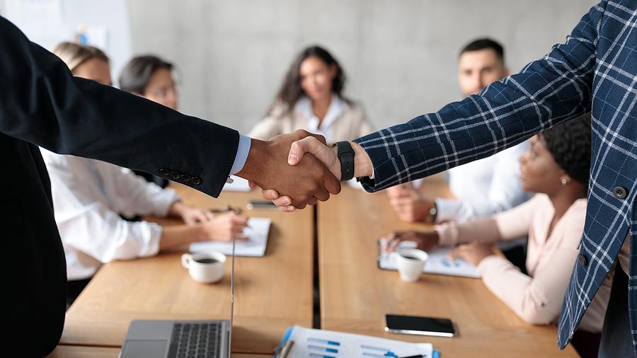 Business Partnership. Closeup Of Handshake At Meeting. Two Busin